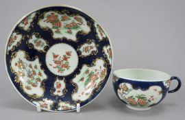 An eighteenth century porcelain Worcester tea bowl and saucer, c. 1760. It is decorated with the