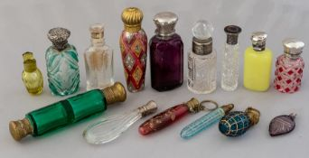 A collection of mainly 19th Century glass scent bottles, cut and moulded glass, some coloured and
