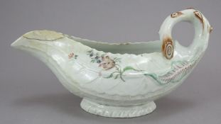 A late eighteenth century porcelain moulded Worcester sauce boat c. 1770. It is of moulded leaf form