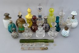 A collection of assorted glass and other dressing table scent bottles, to include a uranium example,