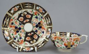 An early nineteenth century hand-painted porcelain Derby cup and saucer, c.1820. It is decorated