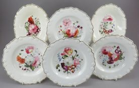 A group of early nineteenth century hand-painted porcelain moulded dessert plates and two single-