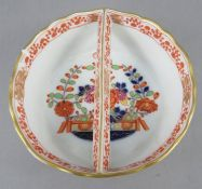 A late eighteenth century Meissen porcelain circular dish with central bar-type handle c. 1790-1810.