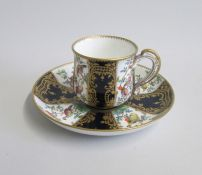 An English Porcelain Cup and Saucer Decorated with Exotic birds and cobalt blue panels with gilt