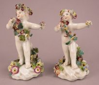 A pair of Derby porcelain cherub figures with encrusted flowers, all hand-painted, c. 1770.