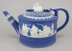 A late eighteenth century Adams (marked) jasper ware teapot and cover c.1785. It has a swan knop