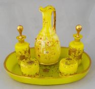 An early 20th Century composite six piece European yellow glass dressing table set, comprising