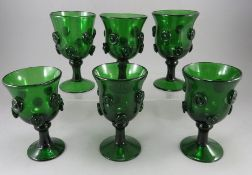 A group of late eighteenth, early nineteenth century green glass roemers with pinched roundels,
