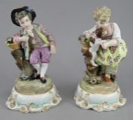 A pair of late nineteenth century Meissen style figures, c.1870. They depict and and a girl.