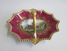 A Chamberlains & Co Worcester Sweetmeat Basket. Claret ground with gilded rim and handle. The centre