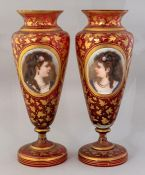 A pair of mid 19th Century European ruby glass baluster vases, circa 1870, applied oval opaque glass