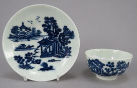 An eighteenth century blue and white transfer-printed porcelain Worcester tea bowl and saucer, c.