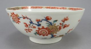 An eighteenth century Bow porcelain waste bowl, c. 1765. It is hand-painted in reds, blues and