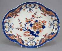 An early nineteenth century Derby porcelain puce mark dessert dish c. 1800. It is painted in blue