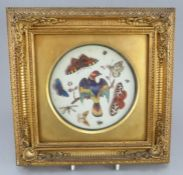 A nineteenth century porcelain plate centre that is cut down and framed, possibly continental, but