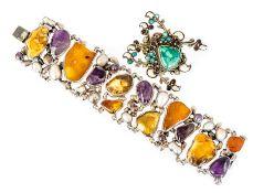**REOFFER IN JAN ATTIC SALE BISHTON £100-£150** A Jan Powianowski sterling silver Bracelet of nine