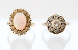 An 18ct opal and diamond cluster Ring, the oval ca
