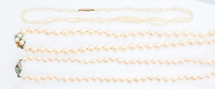 A single string of cultured pearls, creamy white,