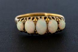 An 18ct five stone opal Ring, claw set five gradua
