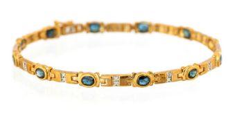 A 9ct yellow gold bracelet set twelve oval cut sap