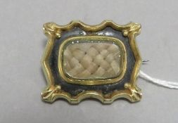 A Georgian memorial brooch with plaited hair to th