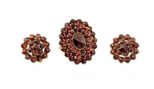 A garnet cluster Ring with central oval rose-cut g
