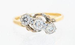 A three stone diamond ring, 18ct and platinum, wit