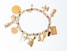 A 10ct yellow gold curb link charm bracelet collet