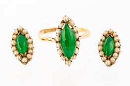 A 14K jade and pearl Ring, claw set marquise shape
