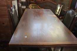 ***LOCATED AT GRESLEY**** Mid 20th Century oak refectory style table with two pullout leaves,