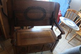***LOCATED AT GRESLEY***Mid 20th Century light oak Monks seat which reverts to a table, lift up