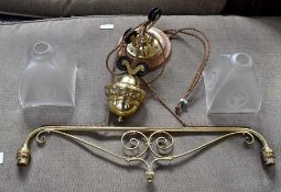 A late 19th or early 20th Century brass two branch gas library lamp, converted to electric, a late