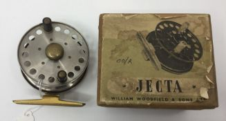 """Angling interest: a boxed 3 inch fishing reel, bass and steel construction. Marked """"Made in"""