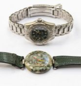 A ladies Tissot 'Rockwatch ' R150 wristwatch comprising a speckled green granite dial, red and