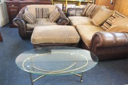***LOCATED AT GRESLEY**** Modern leather and fabric large sofa with pouffe and glass top brass