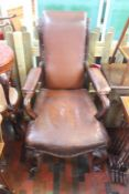 ***LOCATED AT GRESLEY****An early Victorian rosewood armchair with leather seat back and arms, on