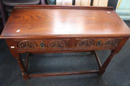 ***LOCATED AT GRESLEY**** A Jacobean style oak hall table, fitted with two short drawers, carved