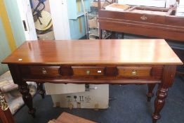 ***LOCATED AT GRESLEY**** Reproduction mahogany hall table with three side by side drawers on turned