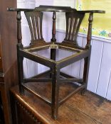 A George III joined oak corner chair, fitted with cross-stretchers, square legs