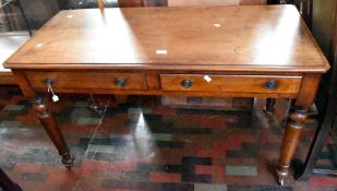 ***LOCATED AT GRESLEY**** A 19th Century mahogany two drawer writing desk, raised on turned legs,