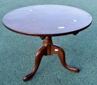 ***LOCATED AT GRESLEY****A George III mahogany tripod table, the top of circular form, 50cm high