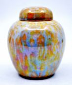 Ruskin Pottery: A Ruskin Pottery ginger jar and cover with yellow/orange and blue/grey speckled