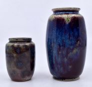 Ruskin Pottery: 2 Ruskin Pottery small ovoid vases in a red and blue mottled glaze. Largest vase