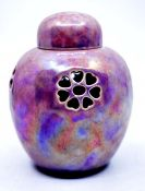 Ruskin Pottery: A Ruskin Pottery lilac lustreware ginger jar and cover with pierced decoration,