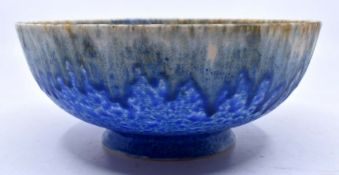 Ruskin Pottery: A Ruskin Pottery bowl with blue ground, cream and pale blue drip glaze from the rim,