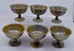 Ruskin Pottery: A Ruskin Pottery set of 6 pedestal footed bowls with speckled lustre glaze, height