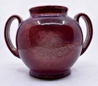 Ruskin Pottery: A Ruskin Pottery sang de boeuf flambe glazed two handled bulbous vase, height approx