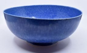 Ruskin Pottery: A Ruskin Pottery bowl with blue mottled glaze, diameter approx 28cm, impressed