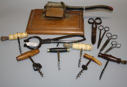 Two 19th century bone handled corkscrews each with single helix, four other corkscrews a pair of