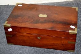 A Victorian mahogany and brass bound writing slope with single well and scriber fitted interior.